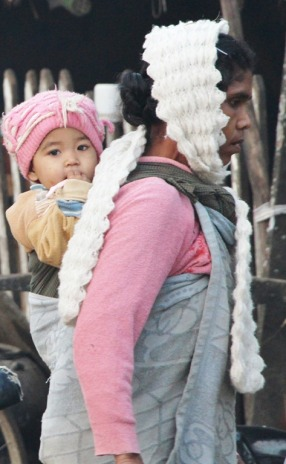 Mother and child going to morning market in Katha