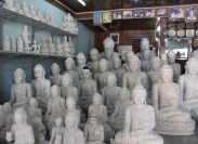 Stone carved Buddha statues of all sizes.