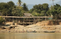 Wooden bridge over stream going into the Irrawaddy
