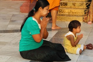 Woman and child praying