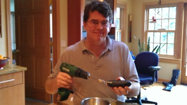 Will uses a drill to hallow out the eggplant for stuffing. My idea. His implementation.