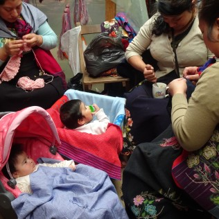 Indigenous Village Zinacantan -- local women embroidering with their babies